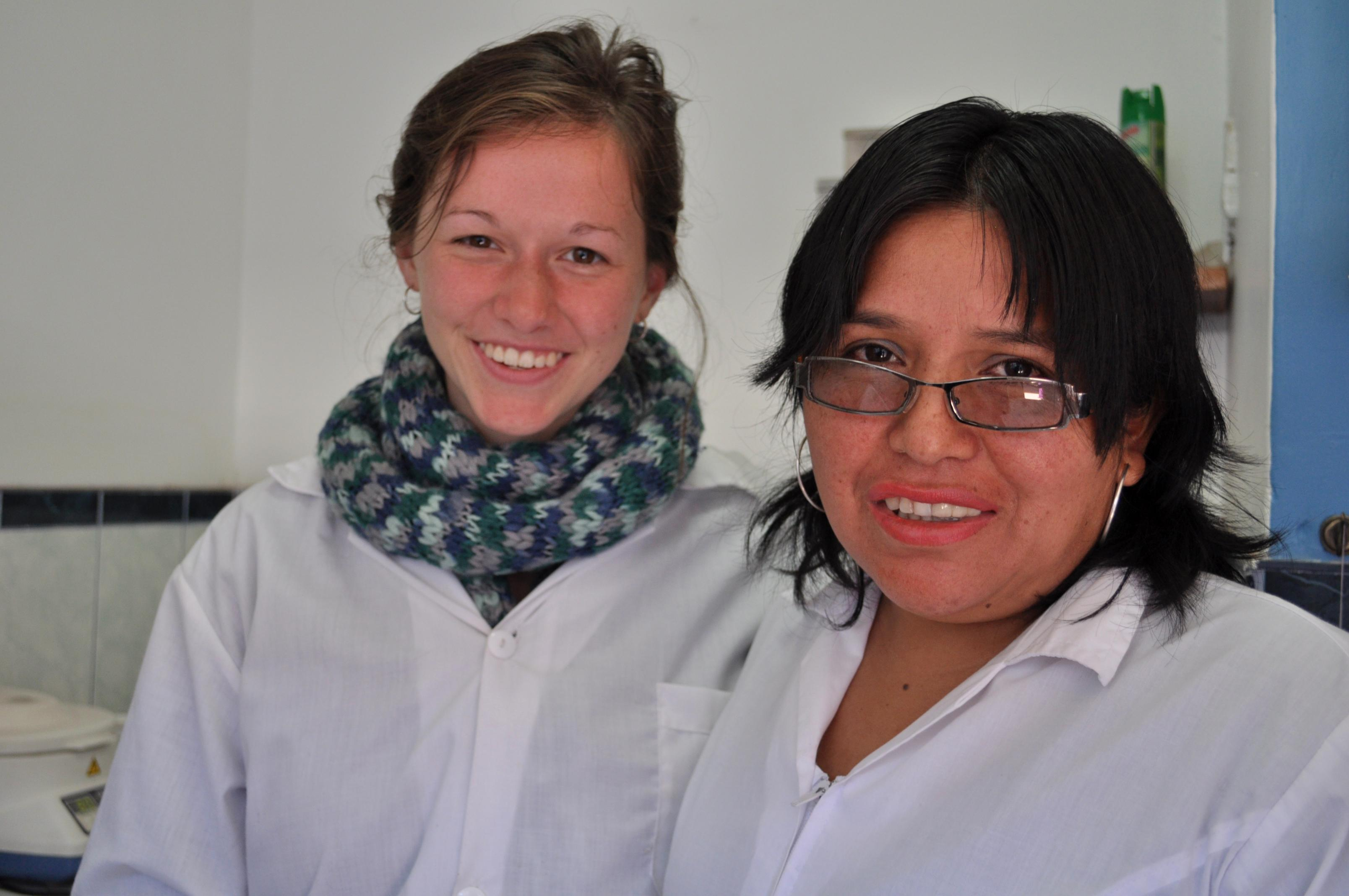 A female Projects Abroad intern is pictured smiling with a local nurse during her midwifery internship in Peru.
